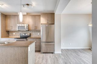 Photo 3: 227 Marquis Lane SE in Calgary: Mahogany Row/Townhouse for sale : MLS®# A1130377