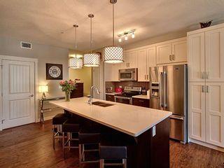Photo 2: 106 130 Auburn Meadows View SE in Calgary: Auburn Bay Apartment for sale : MLS®# A1096320