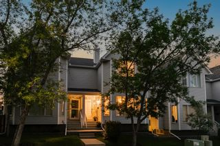 Photo 1: 18 Stradwick Rise SW in Calgary: Strathcona Park Semi Detached for sale : MLS®# A1125011
