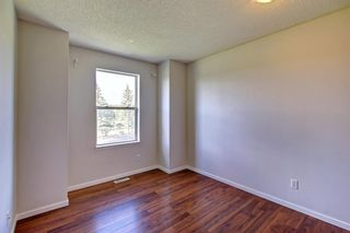 Photo 11: 129 Sandpiper Lane NW in Calgary: Sandstone Valley Row/Townhouse for sale : MLS®# A1106631