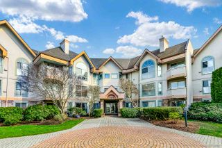 "Photo 1: 307 7171 121 Street in Surrey: West Newton Condo for sale in ""THE HIGHLANDS IN STRAWBERRY HILL"" : MLS®# R2549718"