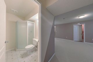 Photo 24: 38 1008 Woodside Way NW: Airdrie Row/Townhouse for sale : MLS®# A1123458