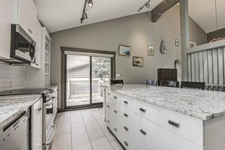 Photo 14: 512 Coach Grove Road SW in Calgary: Coach Hill Detached for sale : MLS®# A1127138