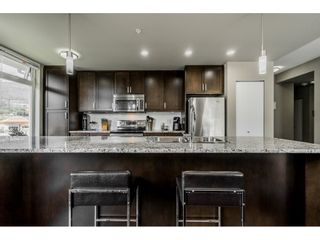"""Photo 9: 410 2242 WHATCOM Road in Abbotsford: Abbotsford East Condo for sale in """"~The Waterleaf~"""" : MLS®# R2372629"""