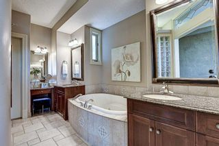 Photo 18: 251 Slopeview Drive SW in Calgary: Springbank Hill Detached for sale : MLS®# A1132385