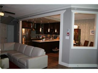 """Photo 3: 105 3600 WINDCREST Drive in North Vancouver: Roche Point Townhouse for sale in """"RAVEN WOODS"""" : MLS®# V1101013"""