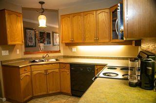 "Photo 2: 307 12464 191B Street in Pitt Meadows: Mid Meadows Condo for sale in ""LASEUR MANOR"" : MLS®# R2548939"
