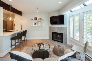 "Photo 2: E2 1100 W 6TH Avenue in Vancouver: Fairview VW Townhouse for sale in ""FAIRVIEW PLACE"" (Vancouver West)  : MLS®# R2189422"