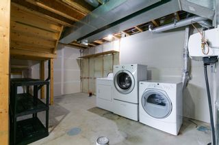 Photo 26: 58 Arbours Circle NW: Langdon Row/Townhouse for sale : MLS®# A1137898