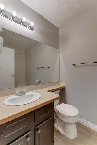 Photo 21: 104 2720 RUNDLESON Road NE in Calgary: Rundle Row/Townhouse for sale : MLS®# C4221687