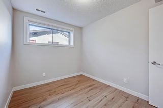 Photo 23: 228 27 Avenue NW in Calgary: Tuxedo Park Semi Detached for sale : MLS®# A1043141