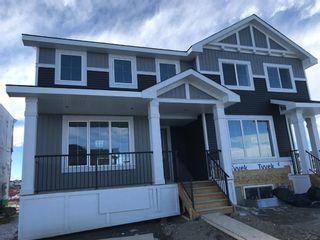 Photo 2: 11 Sundown Manor: Cochrane Semi Detached for sale : MLS®# A1071566