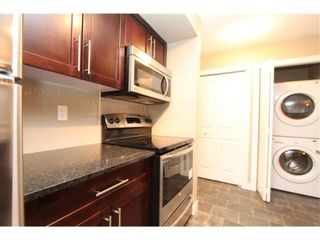 Photo 11: 9104 403 Mackenzie Way SW: Airdrie Apartment for sale : MLS®# A1122241