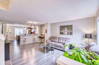 Photo 3: 163 NEW BRIGHTON Villas SE in Calgary: New Brighton Row/Townhouse for sale : MLS®# A1086386