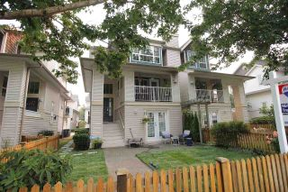 """Photo 1: 18610 65 Avenue in Surrey: Cloverdale BC Townhouse for sale in """"Ridgeway"""" (Cloverdale)  : MLS®# R2299055"""