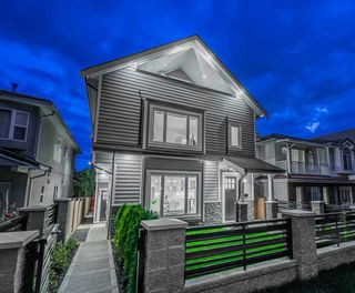 Photo 1: 4541 BEATRICE Street in Vancouver: Victoria VE 1/2 Duplex for sale (Vancouver East)  : MLS®# R2488478