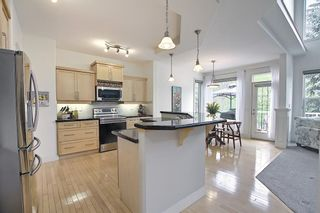 Photo 17: 12 Strathlea Place SW in Calgary: Strathcona Park Detached for sale : MLS®# A1114474