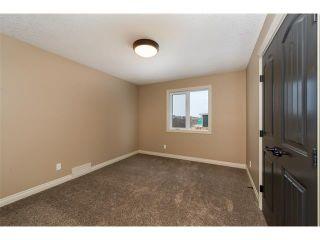 Photo 20: 22 ROCK LAKE View NW in Calgary: Rocky Ridge House for sale : MLS®# C4090662