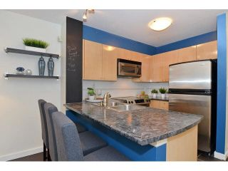 "Photo 6: 108 3278 HEATHER Street in Vancouver: Cambie Condo for sale in ""THE HEATHERSTONE"" (Vancouver West)  : MLS®# V1116295"