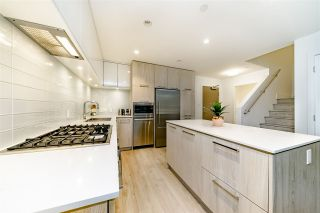 """Photo 7: 103 680 SEYLYNN Crescent in North Vancouver: Lynnmour Townhouse for sale in """"Compass at Seylynn Village"""" : MLS®# R2449318"""