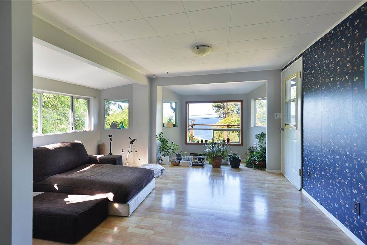 Bright and cheery and sunshine drenched front living room and dining area!