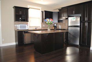 Photo 4: 7280 192 Street in Surrey: Clayton 1/2 Duplex for sale : MLS®# f1026964