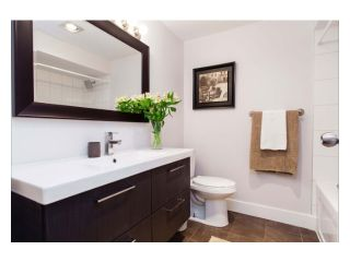 """Photo 8: 102 2299 E 30TH Avenue in Vancouver: Collingwood VE Condo for sale in """"TWIN COURT"""" (Vancouver East)  : MLS®# V1010933"""