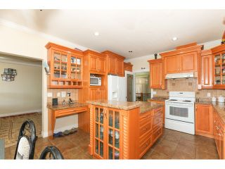 Photo 11: 12550 89A Avenue in Surrey: Queen Mary Park Surrey House for sale : MLS®# F1438329