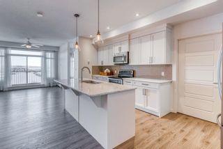 Photo 5: 408 6703 New Brighton Avenue SE in Calgary: New Brighton Apartment for sale : MLS®# A1072646