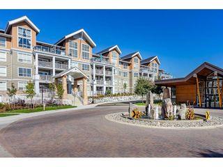 """Photo 1: 210 6490 194 Street in Surrey: Clayton Condo for sale in """"WATERSTONE ESPLANADE GRANDE"""" (Cloverdale)  : MLS®# R2603405"""