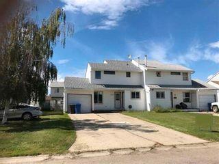 Main Photo: 10620 88A Street in Fort St. John: Fort St. John - City NE 1/2 Duplex for sale (Fort St. John (Zone 60))  : MLS®# R2577676