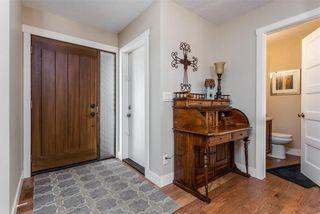 Photo 2: 12 WEST PARK Place: Cochrane House for sale : MLS®# C4178038