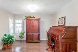 Photo 4: 100 CIMARRON SPRINGS Bay: Okotoks House for sale : MLS®# C4184160