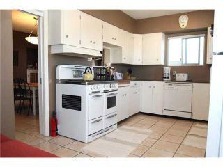 """Photo 5: 5083 NANAIMO Street in Vancouver: Victoria VE House for sale in """"COLLINGWOOD"""" (Vancouver East)  : MLS®# V906111"""