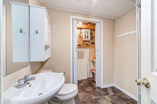 Photo 36: 32 800 Bowcroft Place: Cochrane Row/Townhouse for sale : MLS®# A1106385