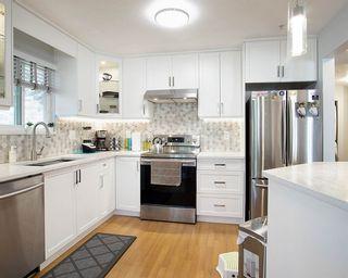 Photo 7: 309 8068 120A Street in Surrey: Queen Mary Park Surrey Condo for sale : MLS®# R2561621