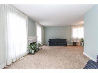 Photo 3: 639 CEDARILLE Way SW in Calgary: Cedarbrae House for sale : MLS®# C4096663