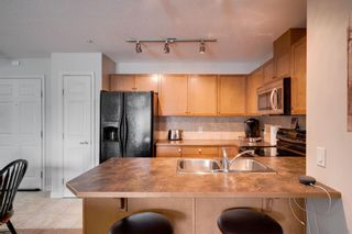 Photo 6: 1302 92 Crystal Shores Road: Okotoks Apartment for sale : MLS®# A1132113