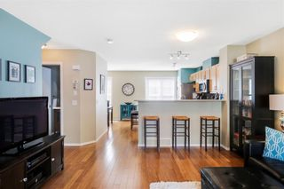 Photo 4: 206 TOSCANA Gardens NW in Calgary: Tuscany Row/Townhouse for sale : MLS®# A1088865
