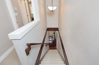 """Photo 11: 101 3333 DEWDNEY TRUNK Road in Port Moody: Port Moody Centre Townhouse for sale in """"CENTREPOINT"""" : MLS®# R2378597"""
