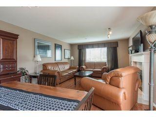 "Photo 3: 313 13860 70 Avenue in Surrey: East Newton Condo for sale in ""CHELSEA GARDENS"" : MLS®# R2175558"