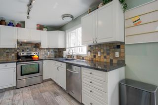 Photo 14: 106 23 Avenue SW in Calgary: Mission Row/Townhouse for sale : MLS®# A1123407