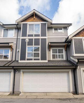 "Photo 1: 62 12677 63 Avenue in Surrey: Panorama Ridge Townhouse for sale in ""Sunridge"" : MLS®# R2554873"