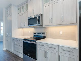 Photo 12: 66 Skyview Parade NE in Calgary: Skyview Ranch Row/Townhouse for sale : MLS®# A1053278