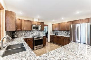 Photo 5: 87 Canata Close SW in Calgary: Canyon Meadows Detached for sale : MLS®# A1090387