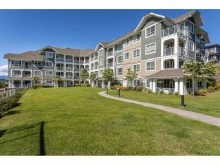 """Photo 2: 104 16398 64 Avenue in Surrey: Cloverdale BC Condo for sale in """"The Ridge at Bose Farm"""" (Cloverdale)  : MLS®# R2590975"""