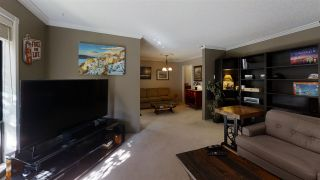 """Photo 2: 10573 HOLLY PARK Lane in Surrey: Guildford Townhouse for sale in """"Holly Park Lane"""" (North Surrey)  : MLS®# R2461825"""
