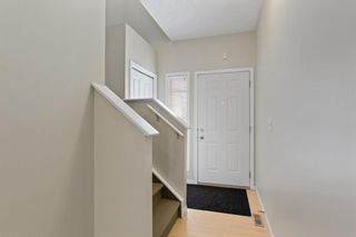 Photo 2: 94 Everridge Gardens SW in Calgary: Evergreen Row/Townhouse for sale : MLS®# A1069502
