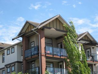 """Photo 2: 430 5660 201A Street in Langley: Langley City Condo for sale in """"Paddington Station"""" : MLS®# R2596391"""