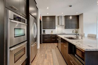 Photo 3: 127 Springbluff Boulevard SW in Calgary: Springbank Hill Detached for sale : MLS®# A1140601
